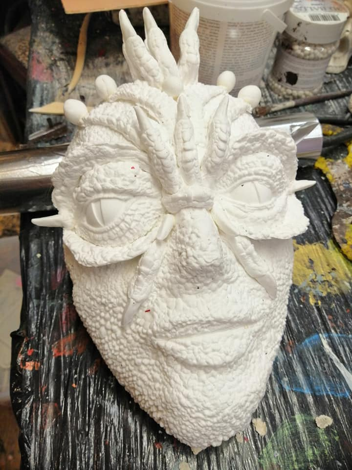 Masked covered with paper clay